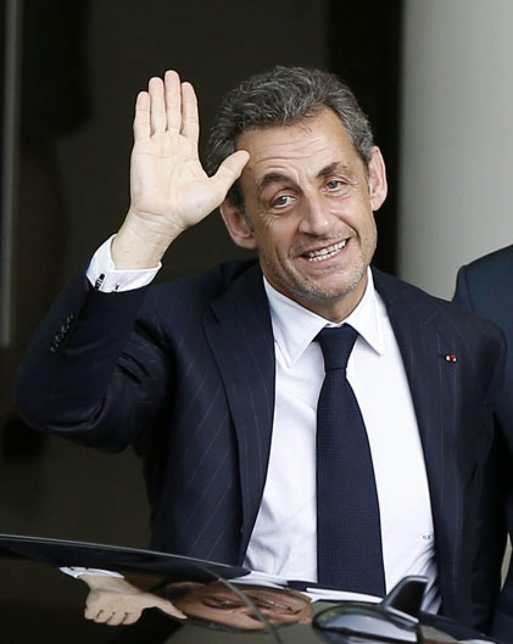 L'ancien président français Nicolas Sarkozy photographié à Monaco, le 18juin dernier, après avoir prononcé une conférence privée. Soupçonné de trafic d'influence et de violation du secret de l'instruction, il a été mis en examen après un long interrogatoire.