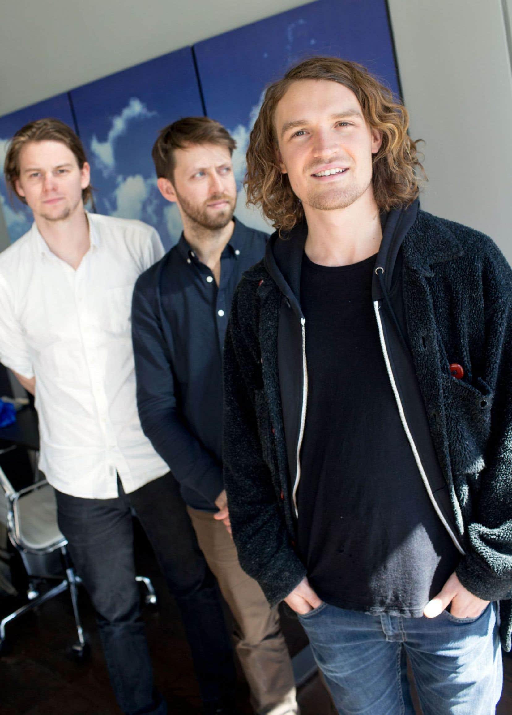 Isaac Symonds, en avant-plan, avec Dylan Philips et Conner Molander derrière. Devon Portielje, absent sur la photo, complète Half Moon Run.