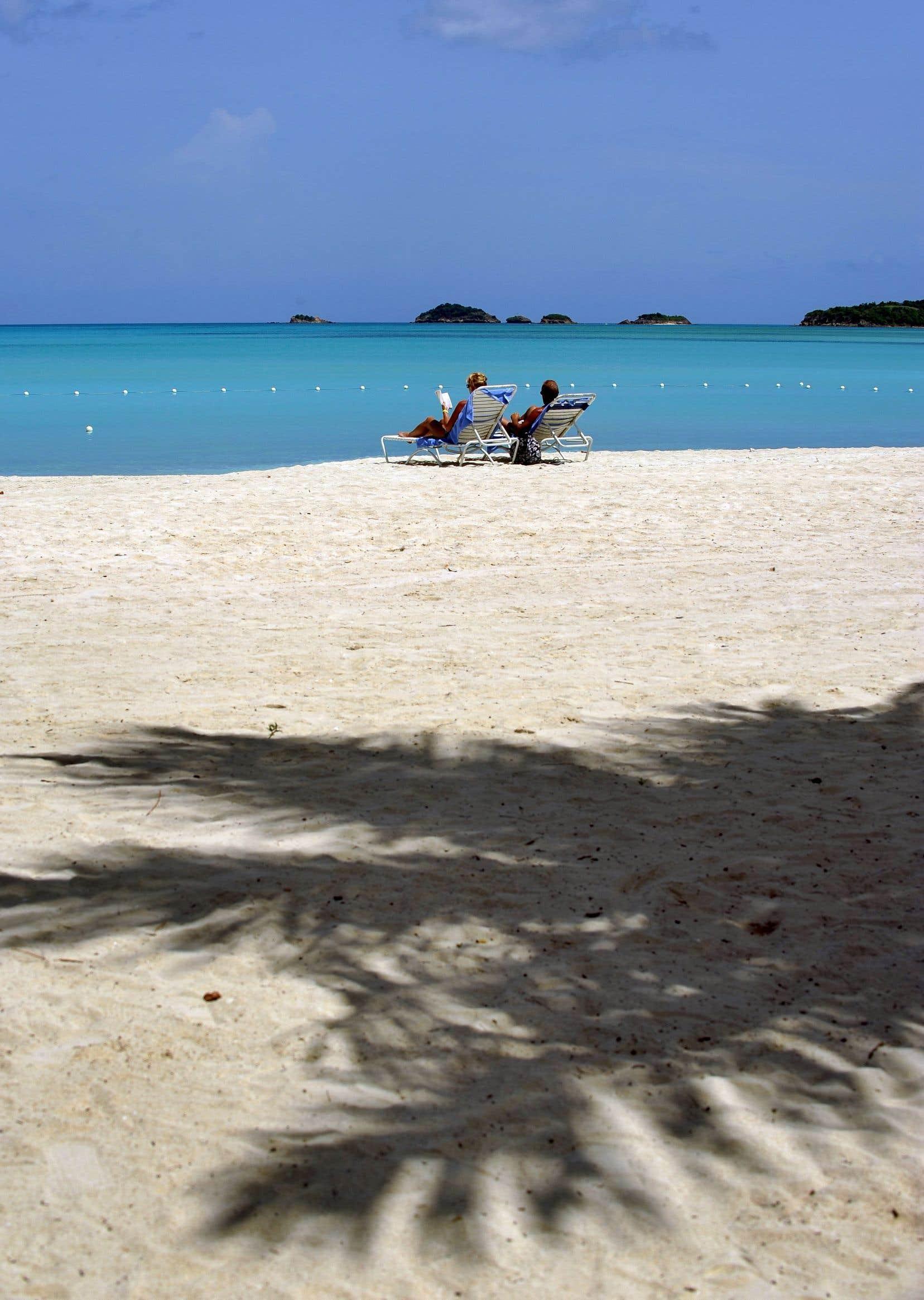 La fiscaliste Marwah Rizqy déplore le peu de progrès réalisés jusqu'à présent dans le combat contre les paradis fiscaux et cite l'exemple de deux nouvelles ententes fiscales conclues récemment avec Grenade et Antigua-et-Barbuda (photo), deux paradis fiscaux notoires.