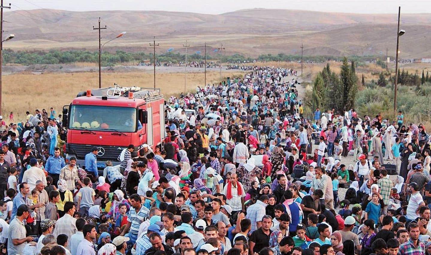 Affamés et effrayés, des milliers de Kurdes syriens fuient en Irak