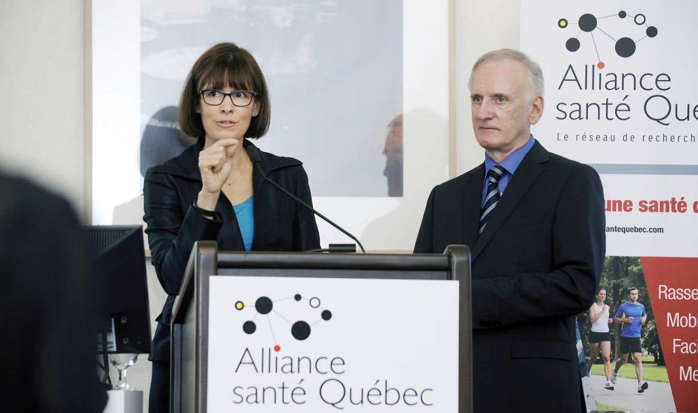 La vice-rectrice à la recherche et à la création de l'Université Laval, Sophie D'Amours, et l'homme d'affaires et président de l'Alliance santé Québec, Michel Clair