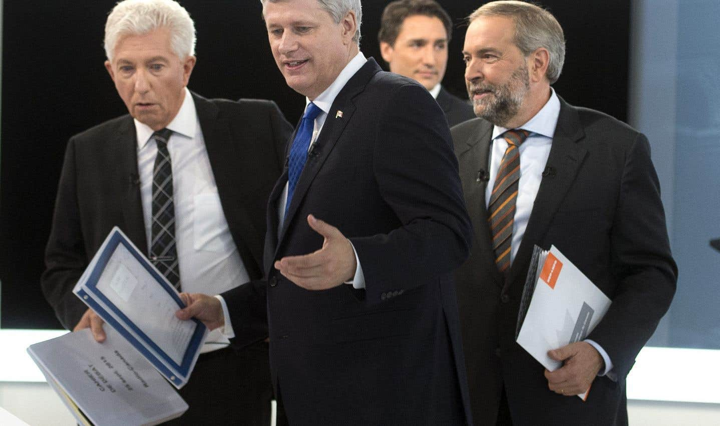 Stephen Harper, Gilles Duceppe, Thomas Mulcair et Justin Trudeau lors d'un des débats des dernières élections fédérales.