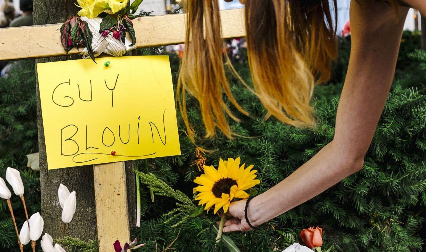 Guy Blouin est mort à l'hôpital, quelques minutes après que le policier l'eut heurté avec son véhicule en marche arrière.