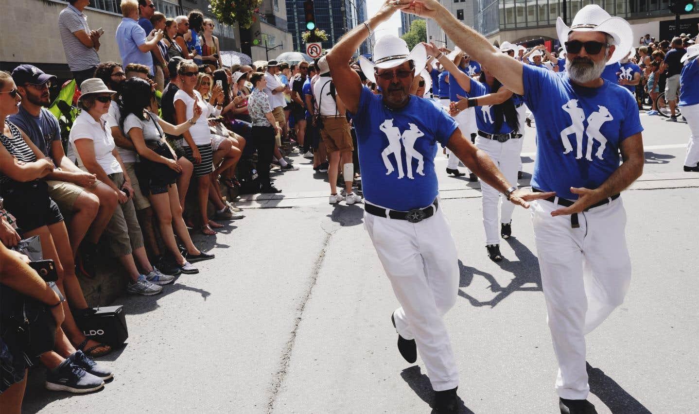 Le grand défilé clôture les célébrations du festival Fierté Montréal.