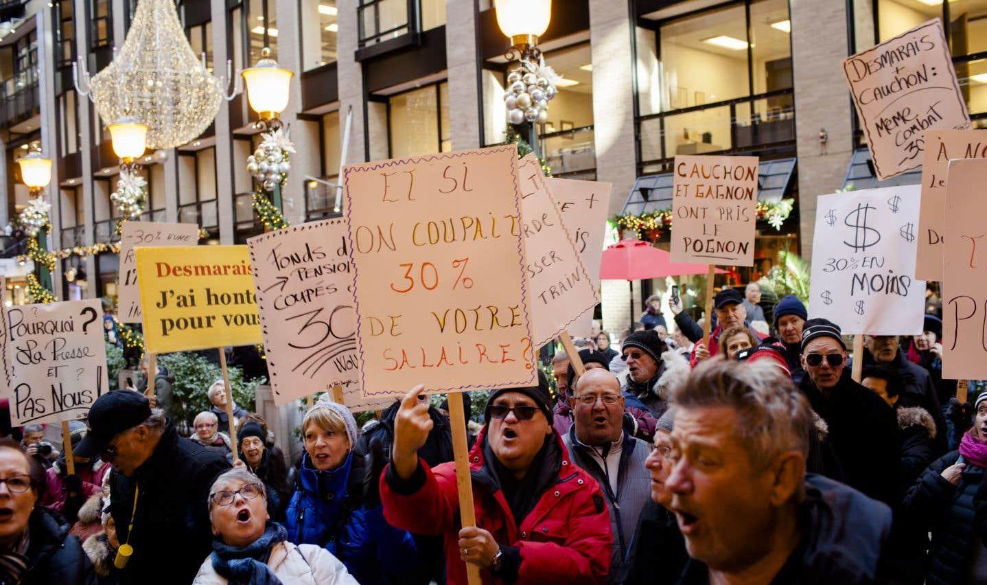 Environ 200 retraités des journaux du Groupe Capitales Médias ont manifesté le 11 décembre devant les bureaux de Power Corporation à Montréal. Au total, 950 d'entre eux risquent de perdre le tiers de leurs prestations de retraite.
