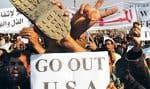 Une chaussure était brandie par des manifestants hier à Bagdad, en référence à l'incident qui a marqué dimanche la visite-surprise de George W. Bush en Irak.