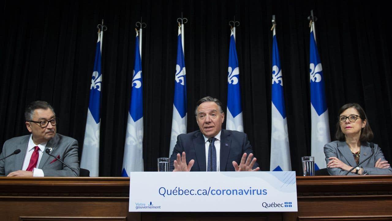 Le directeur de la santé publique du Québec, Horacio Arruda, le premier ministre François Legault et la ministre de la Santé Danielle McCann.