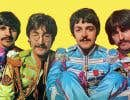 Ringo Starr, John Lennon, Paul McCartney et George Harrison portant l'uniforme (devenu légendaire) associé à l'album «Sgt. Pepper's Lonely Hearts Club Band»